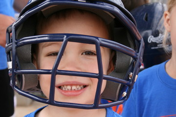 Child in Baseball Helmet