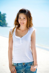 young woman smiles by the beach
