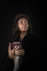 Woman with Bible Eyes Up Light