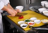 Chef preparing vegetable poster
