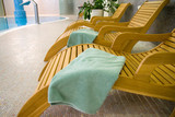 Sunbeds in the fitness with tranquil towel poster