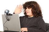 boy using laptop, waving hand of a webcam poster