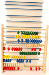 abacus calculator with colored beads and books