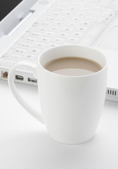 Coffee and laptop computer
