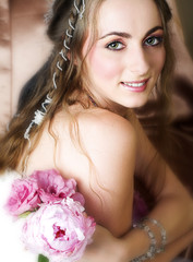 Beautiful happy young bride with long brown hair