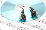 earphones, cd and sheet music poster