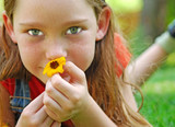 Young Girl Sniffing Wildflower poster