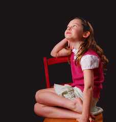Young Girl Thoughtful in Chair