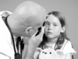 Doctor Examing Girl's Eye