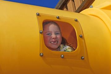 Girl in Playground Slide Tube