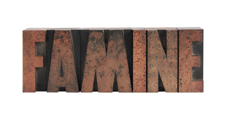 the word 'famine' in old, ink-stained wood type