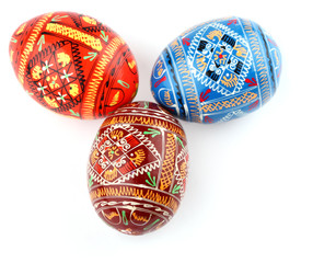three russian tradition easter eggs side by side over white