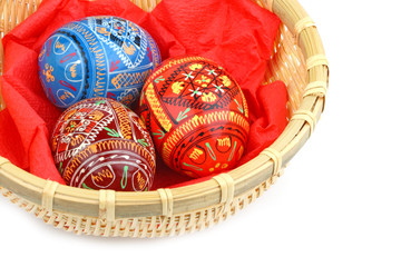 three russian tradition easter eggs in yellow basket close up ov