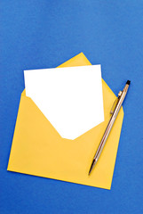 A bright yellow envelope with blank notecard.