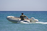rubber dinghy with captain poster