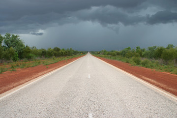 Dark clouds above the road