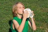 child with allergy sneezing and blowing nose poster