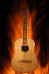 Acoustic guitar on fire background