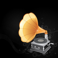 Gold gramophone on a dark background