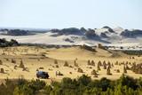 Camper van in the Pinnacles desert in Western Australia poster