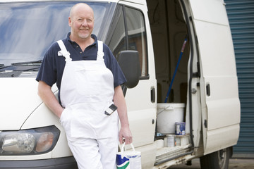 Decorator Standing Next To White Van