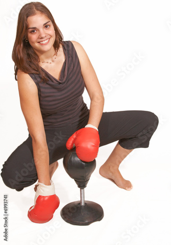 Friendly boxing girl sits
