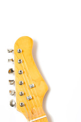 part of guitar on white