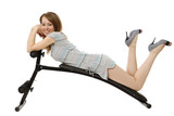 girl lies on the  training apparatus poster