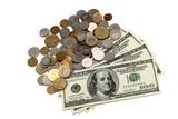 Hunder dollar bills and a heap of coins