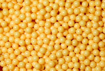 A pile of yellow round balls.