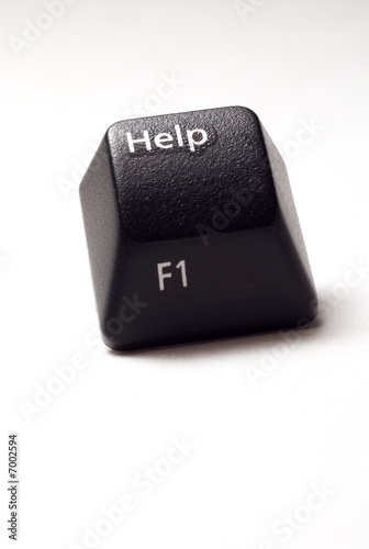 A black computer keyboard isolated help button.