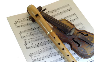 RECORDER,OLD VIOLIN ON MUSIC SHEET