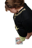 women with overweight looking on scales poster