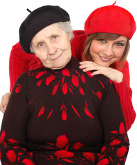 happy grandmother and granddaughter with berets