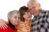 happy grandparents and granddaughter looking at camera poster