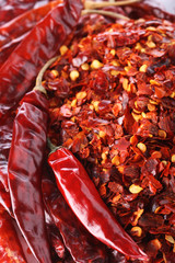 Hot Red Chilli Chillies pepper whole and crushed Background