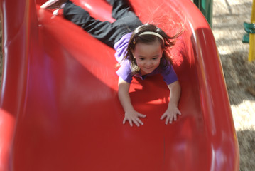 little girl playing in playground at atlanta zoo