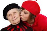 granddaughter kiss grandmother cheek poster