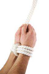 A man's hands tied of white rope