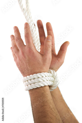 Hands tied with white rope