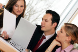 dynamic business team on a laptop in an office
