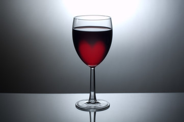 Glass of wine with heart shaped glow