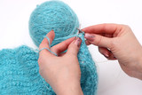 knitting a pullover poster