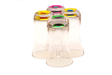Four short drinking glasses