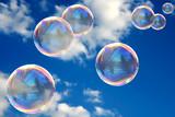 Soap bubbles on blue sky - 7066748