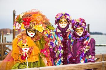 Three people in Venetian Costume