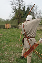 a medieval archer acting during an italian fair