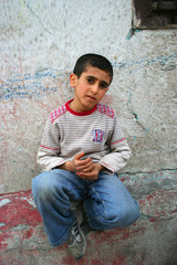 Boy sitting on the wall