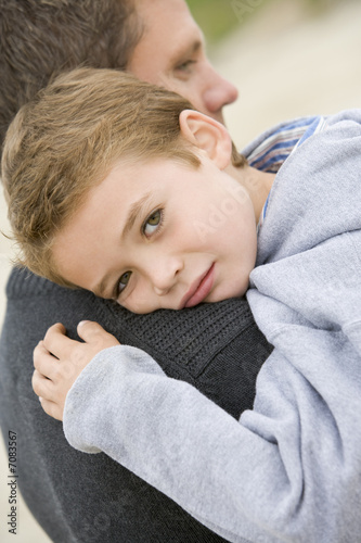 Son giving Father cuddle