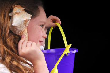 Girl Listening to Seashell